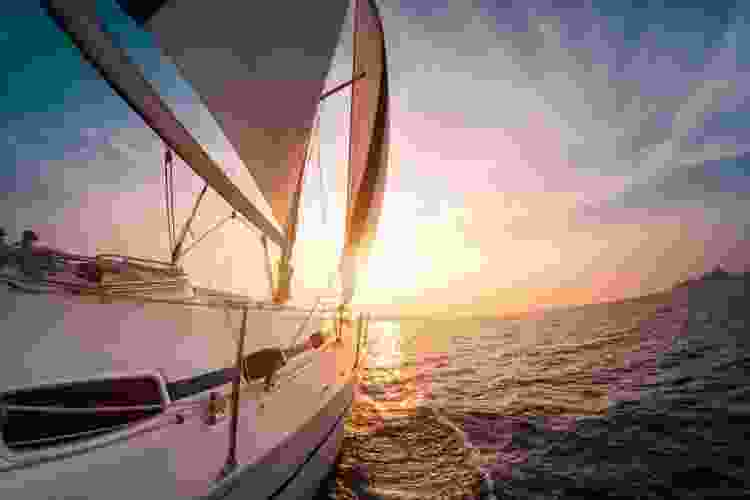 sail boat on the water during sunset