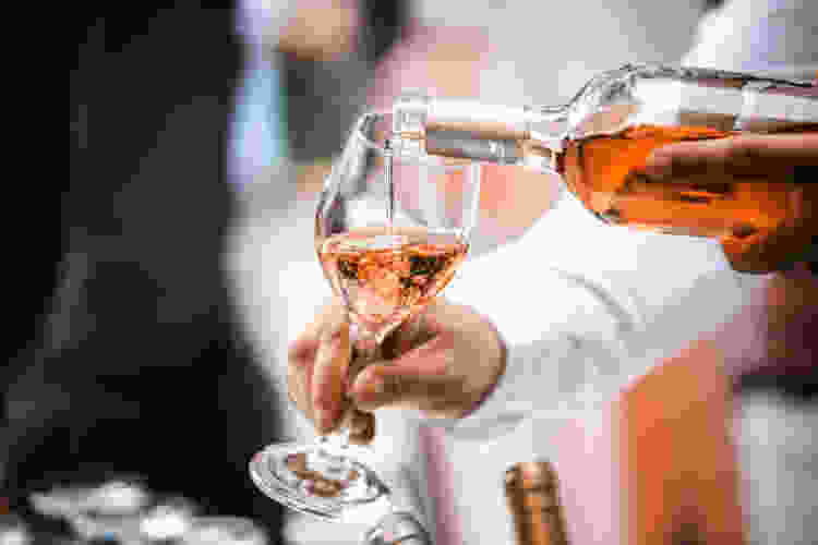 server pouring white zinfandel
