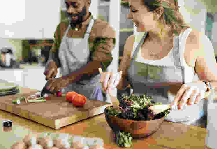 couple practicing healthy cooking together in the kitchen