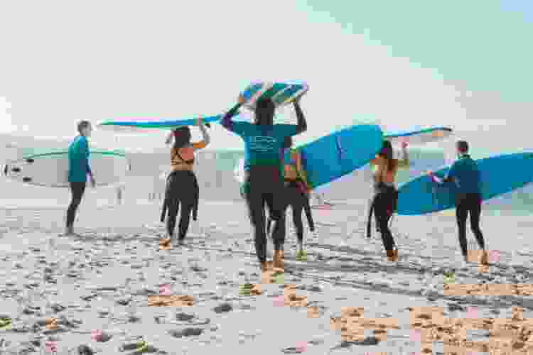 go surfing for a fun team building activity in san diego