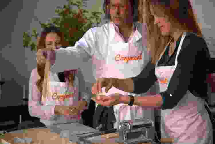 chef with teammates during a team building cooking class