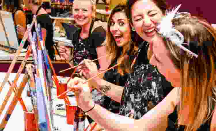 visiting a paint bar makes for fun team building activities in boston