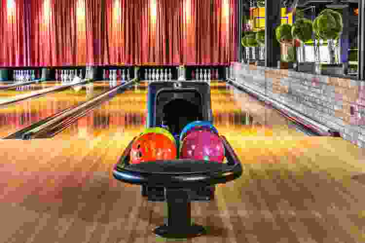 bowling alley and colorful bowling balls at the painted pin