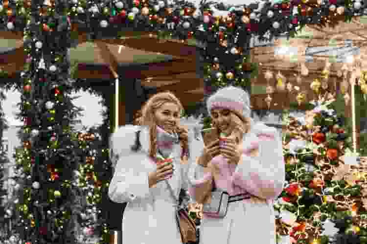 friends outside on a holiday scavenger hunt