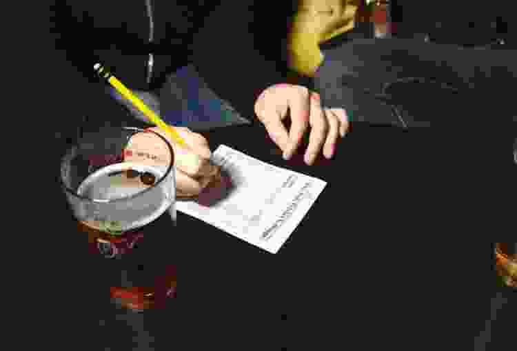 playing trivia at a bar