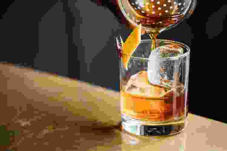 pouring a whiskey sour