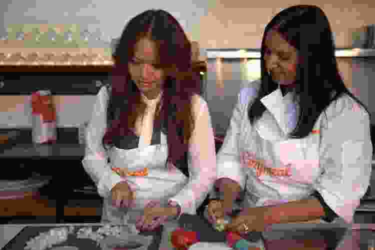 coworkers prepping food in a culinary team building activity