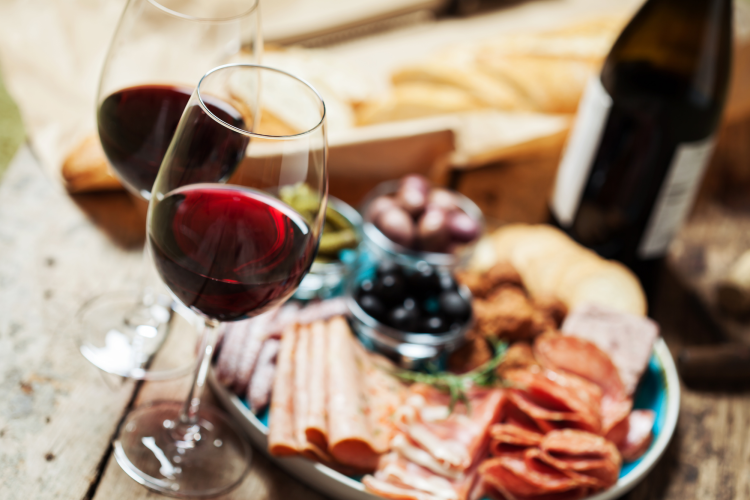 glasses of red wine with charcuterie