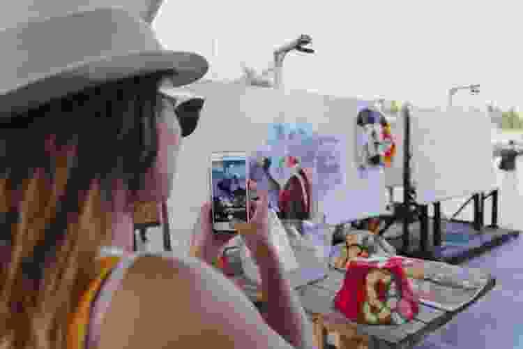 woman taking photos at the wynwood art walk