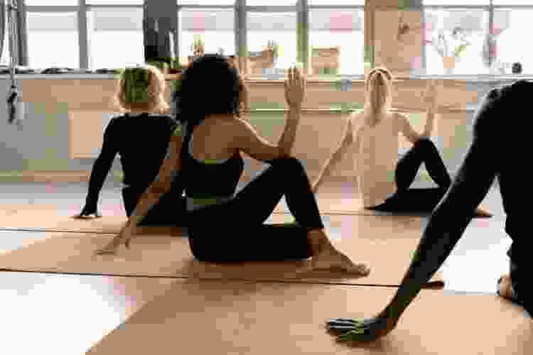 colleagues taking a yoga class together