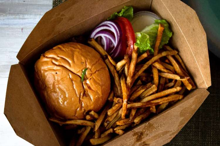 burger and fries in a takeout box