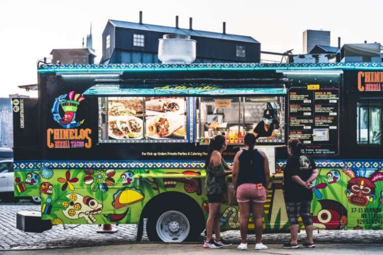 friends stopping for a bite at a food truck