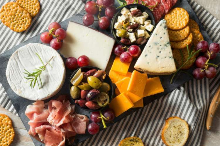 Charcuterie board with cheese, crackers, grapes and meat