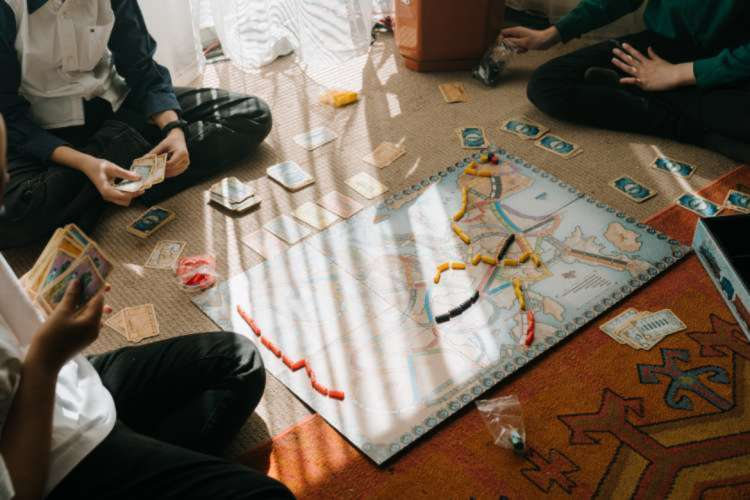 friends playing a board game