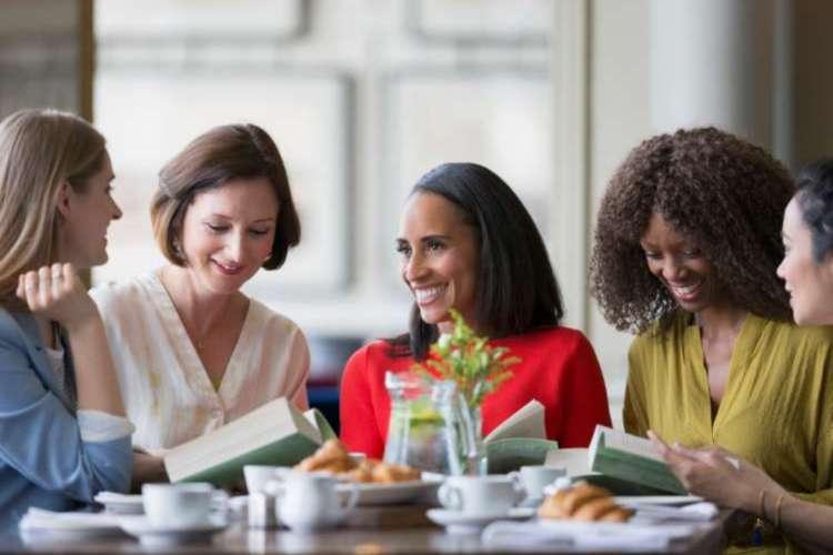 friends enjoying their books during a book club meeting