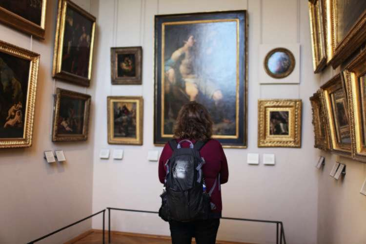 Woman admiring art in a museum
