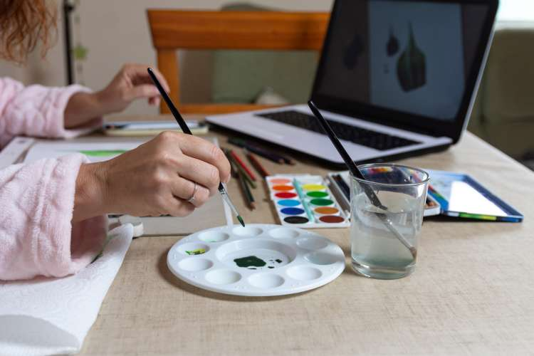 women painting with virtual online painting class