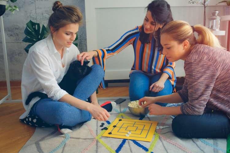 women playing board games