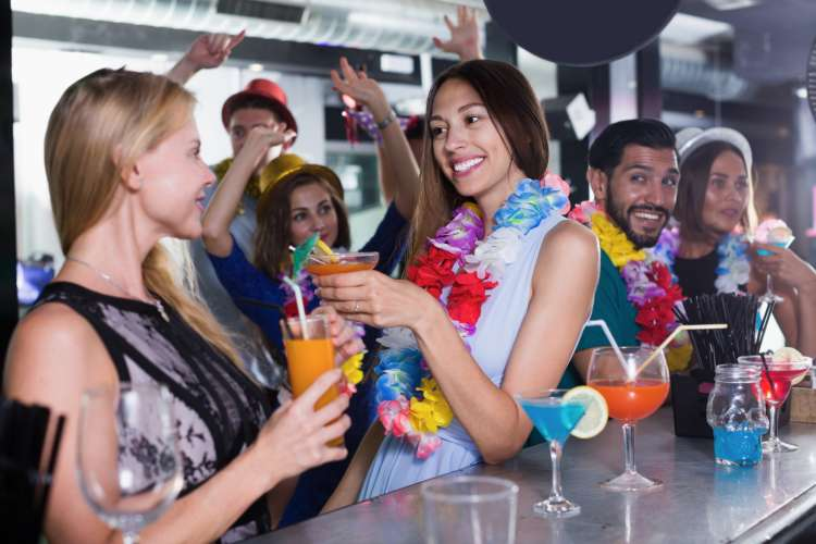 group of people enjoying a Hawaiian theme luau party