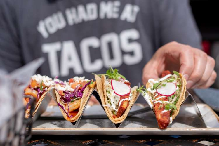 hand reaching for tacos