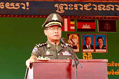 General Vong Ping Sen considers the...