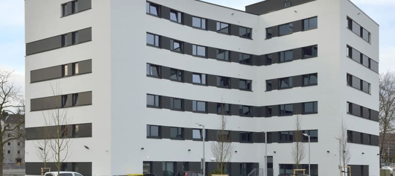 hotel duisburg exterior and parking lot by day