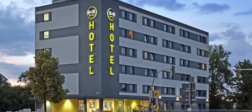 Hotel Regensburg outside view exterior facade design signage logo evening