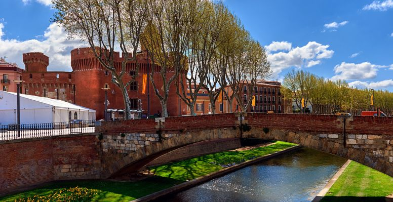 View of the canal and the castle of Perpignan