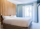 Habitación doble con cabecero pino Hotel B&B Fuencarral 52