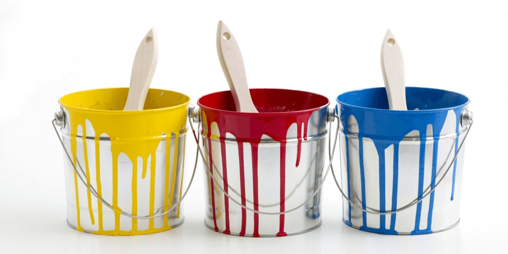 Primary color paints in buckets - color your life!