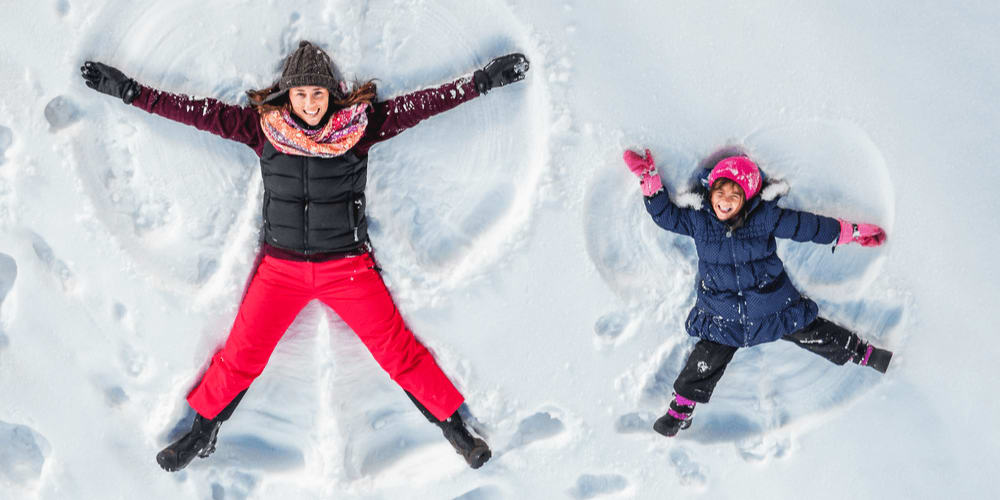 Make snow angels with your children.