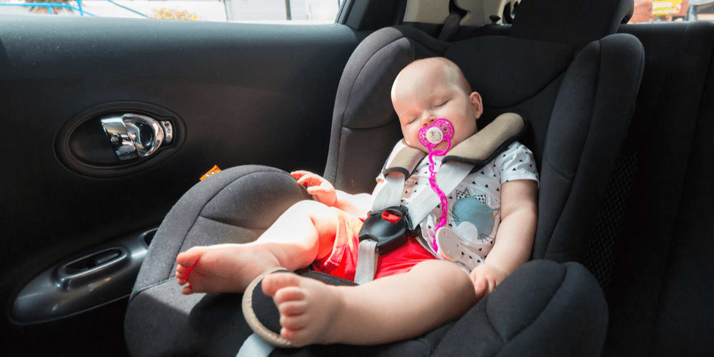 Baby in a car in summer