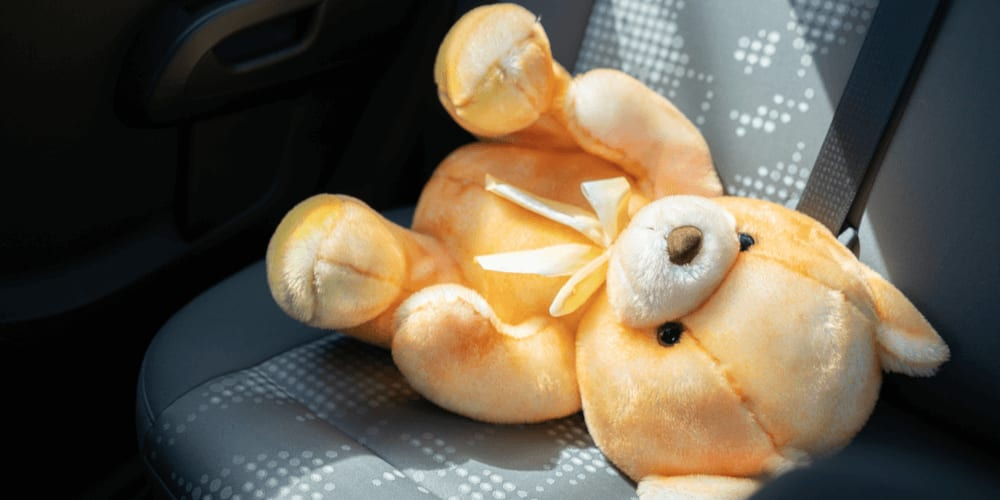 Leave a stuffed toy near you when you're driving with a child in the back
