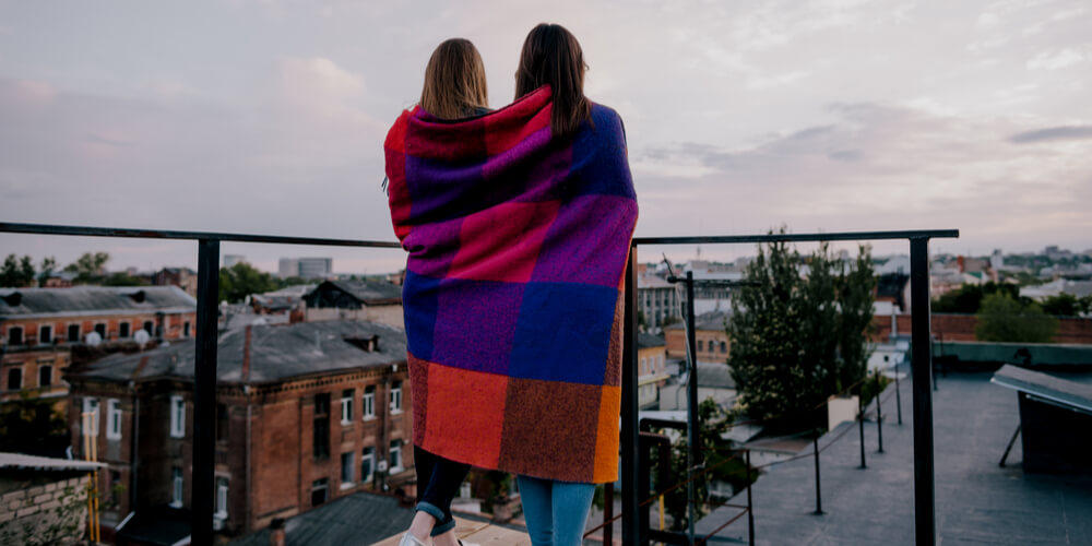Two girls in a blanket