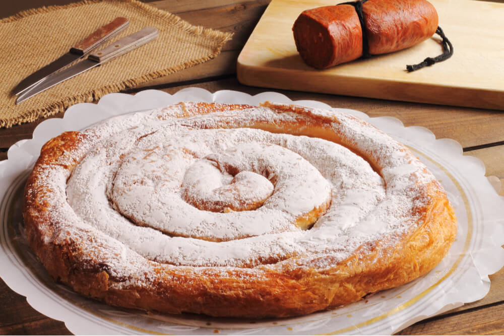 Ensaimada pastry and sobrasada sausage are two traditional dishes one must try in Mallorca.