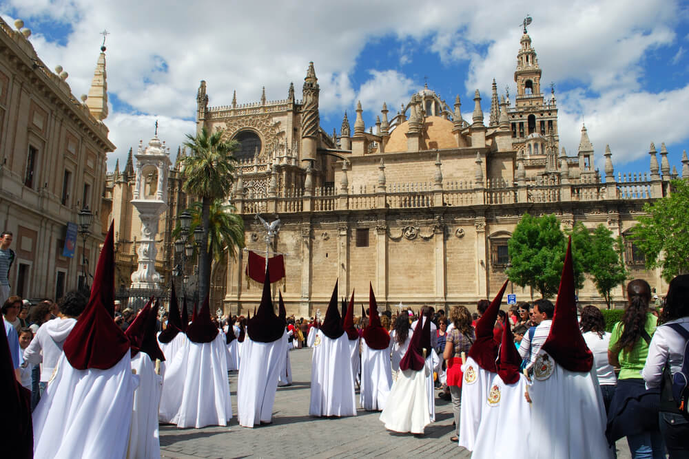 Group of penitentes in front of the Seville Cathedral