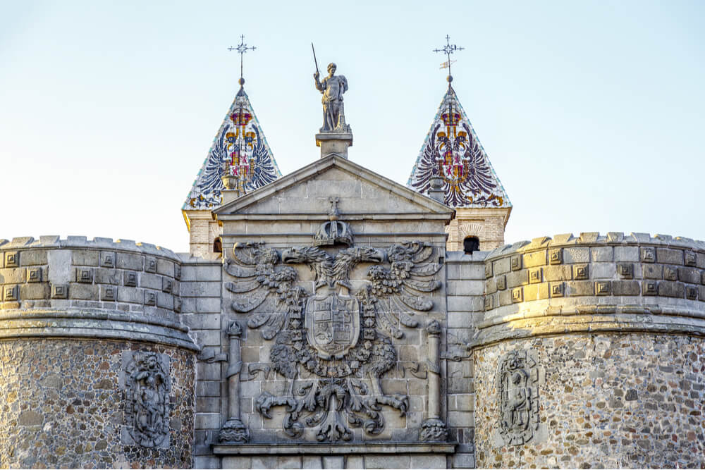Detailed view of Bisagra gate with the coat of arms in Toledo, Spain