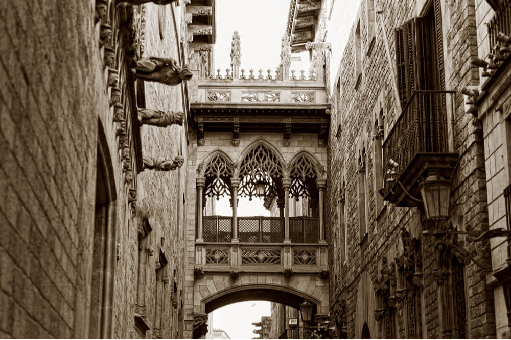 Covered bridge between two buildings in the Gothic Quarter.