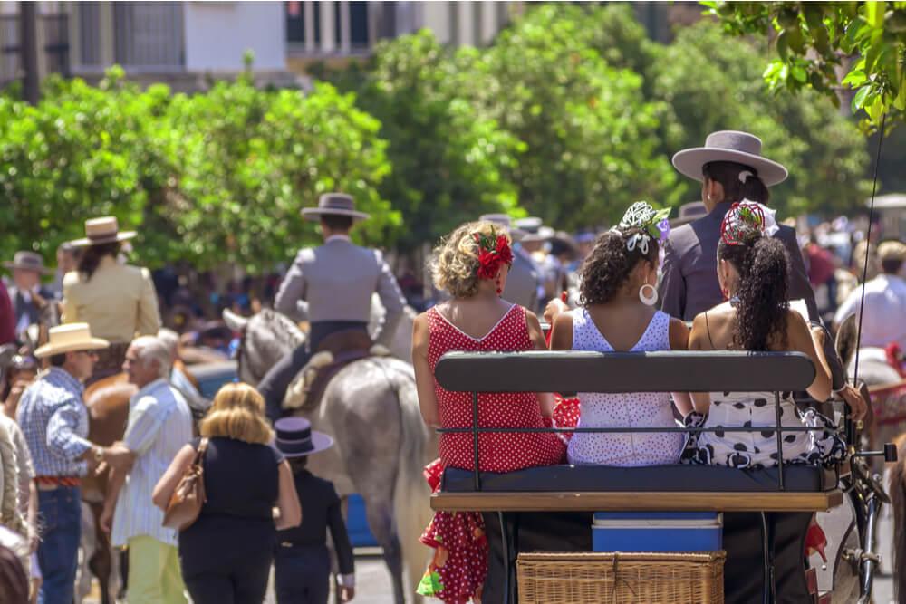 A horse cart carrying passengers during Feria de Málaga.