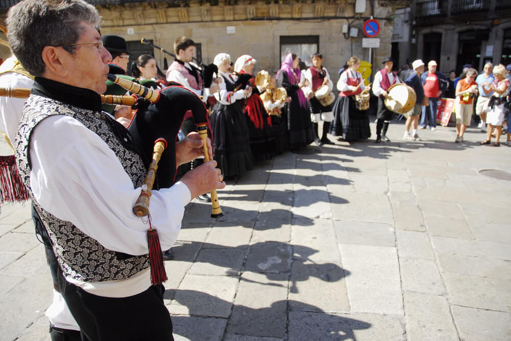 Bagpipers wearing traditional costumes in Santiago de Compostela.