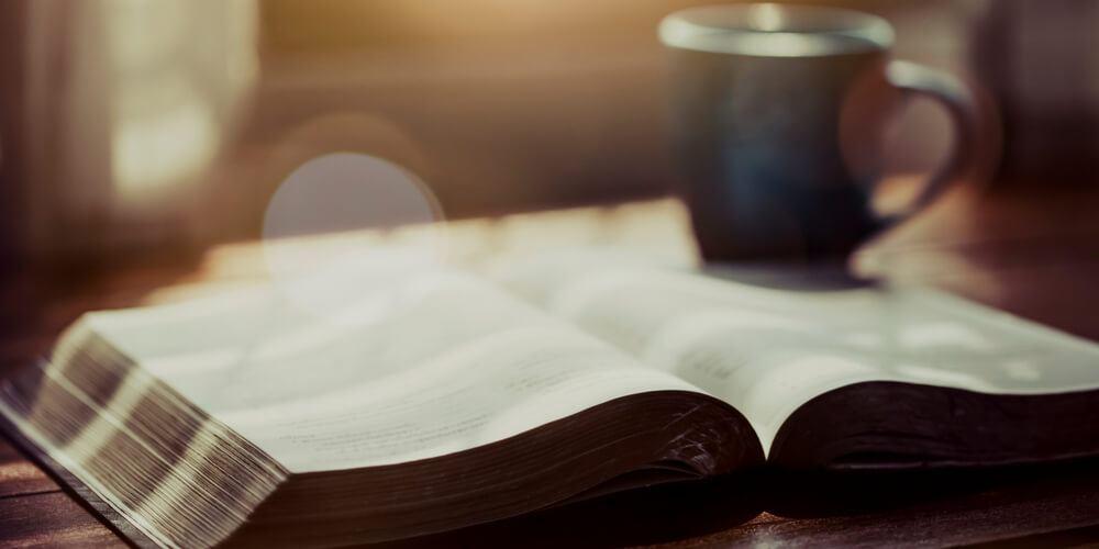Bible and a mug