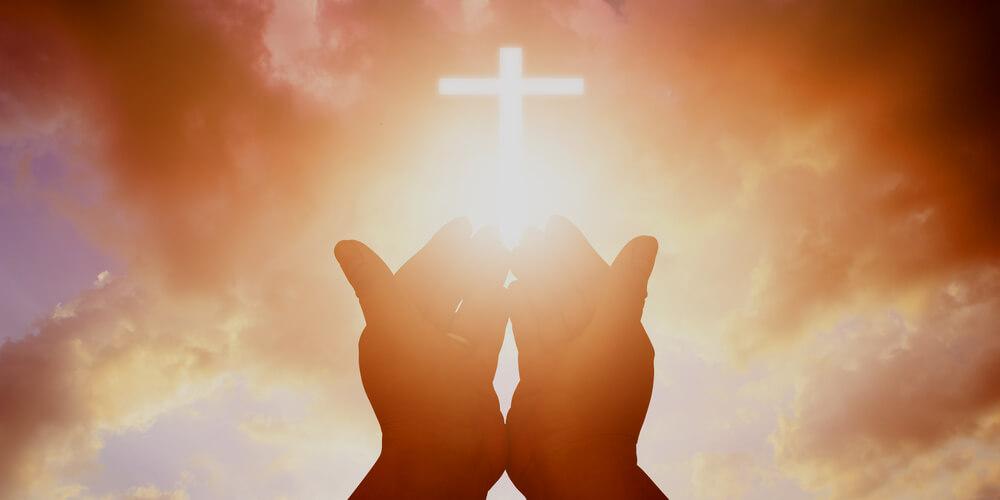 Man with a light cross