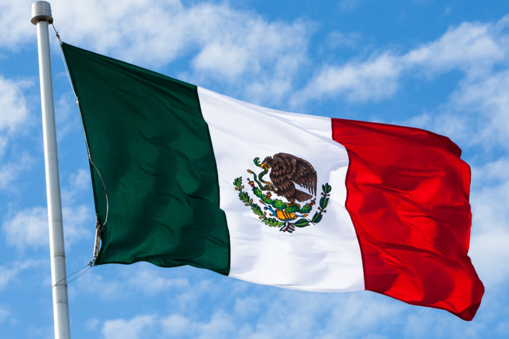 Mexican flag is a tricolor with a coat of arms in the center.