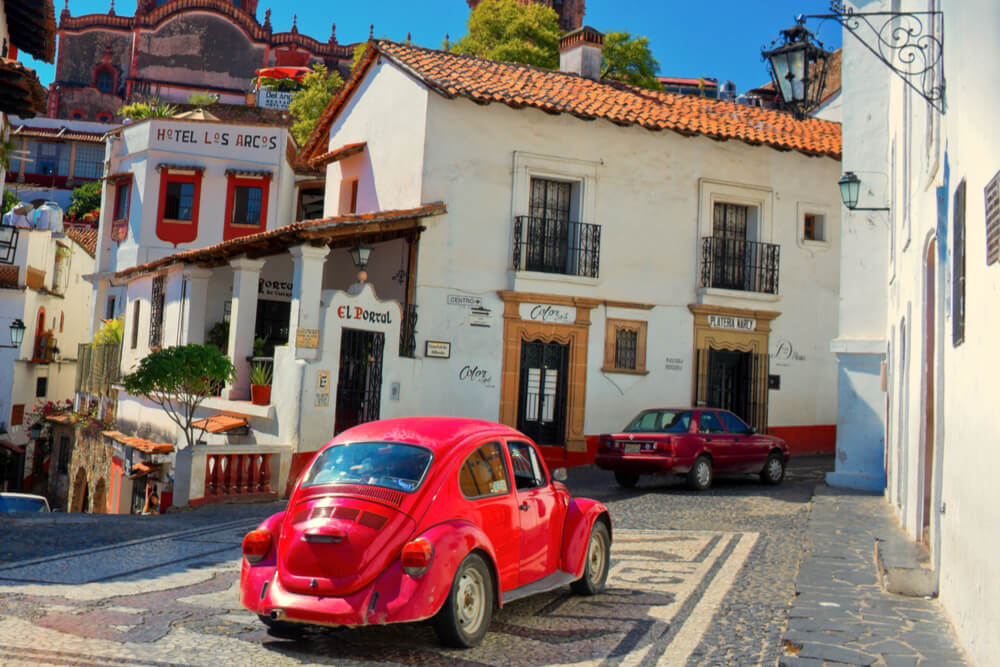 Architecture and taxi of Taxco, Mexico - a town known for its silver products.