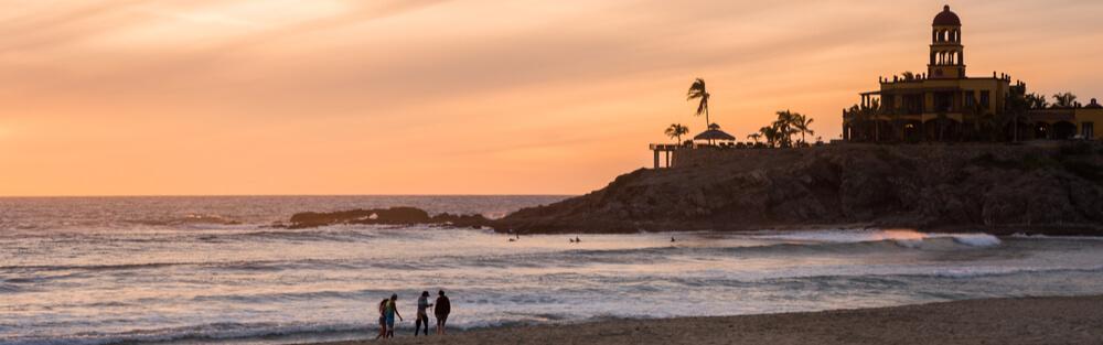 Vast beach at sunset in Todos Santos, Mexico
