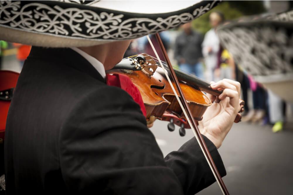 Mariachi musicians wear wide-rimmed sombreros