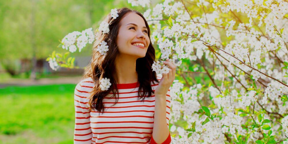 Beautiful girl near a Spring tree