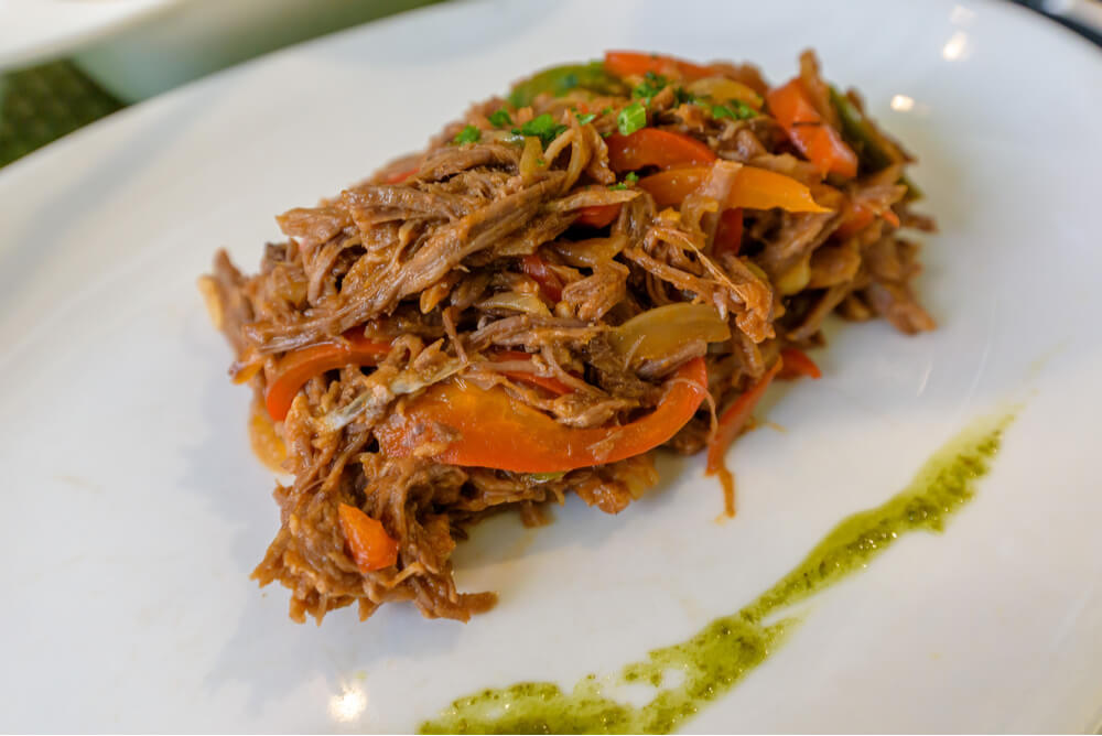 Ropa vieja, traditional Cuban national dish made of shredded beef and vegetables