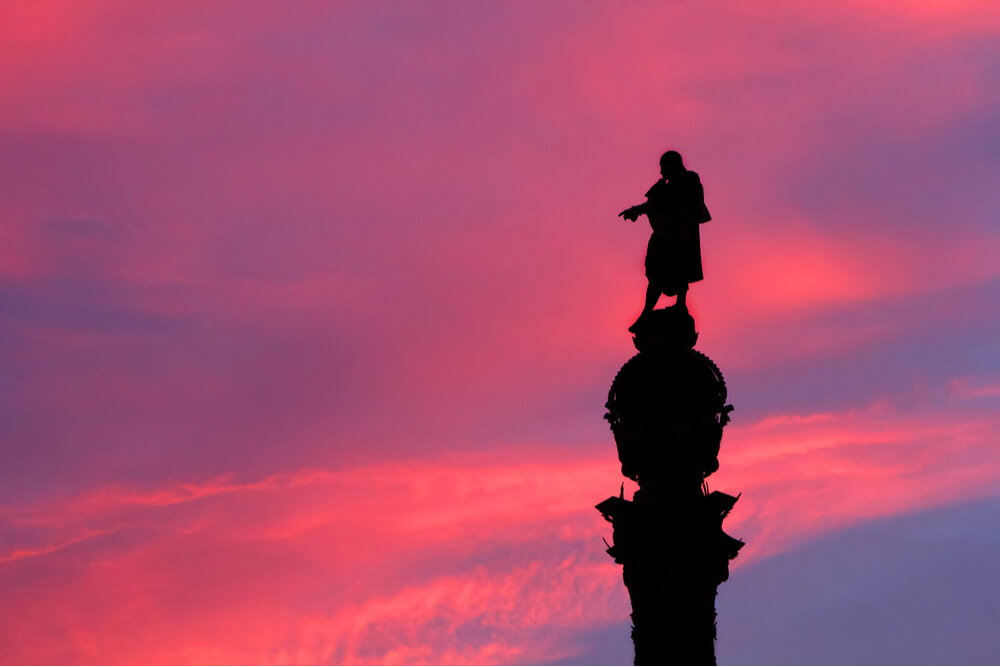 The silhouette of the Monument of Columbus at pink sunset in Barcelona, Spain
