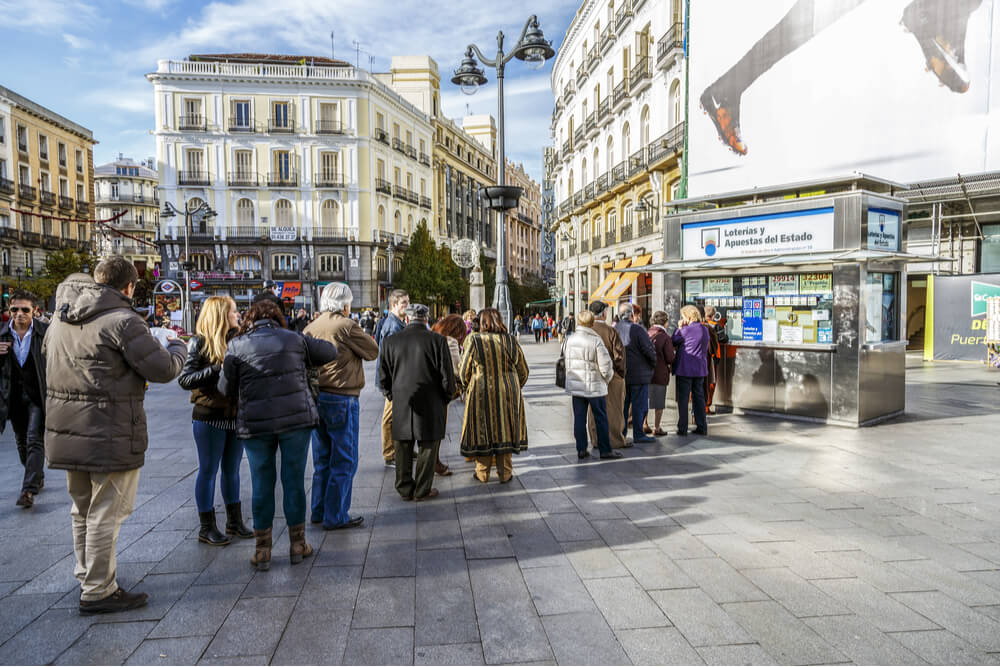 A typical Christmas queue to buy national lottery in the famous Puerta del Sol in Madrid, Spain